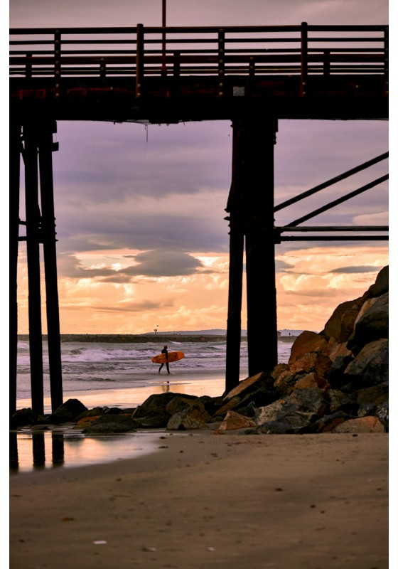 Surfer Under the Pier